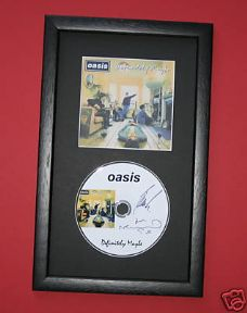 OASIS - DEFINITELY MAYBE CD DISC MEMORABILIA presentation